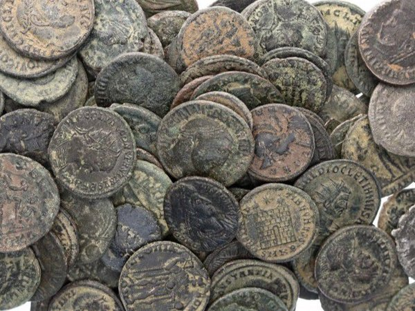 Old bronze coins representing varied geocoins
